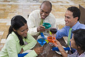 Hispanic couples toasting with cocktails — Stock Photo