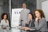 Senior African businessman giving presentation — Stock Photo