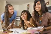 Hispanic teenaged girls studying — Stock Photo