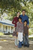 Multi-ethnic family in front of house — Stock Photo