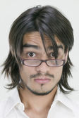 Young Hispanic man wearing eyeglasses — Stock Photo