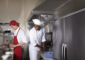 Multi-ethnic male chefs preparing food — Stock Photo