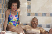 Multi-ethnic senior couple in hot tub — Foto Stock