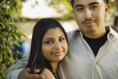 Teenaged Hispanic couple hugging — ストック写真