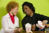African couple eating takeout food — Stock Photo