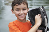 Boy wearing baseball mitt — Stock Photo