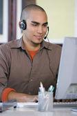 African American businessman wearing headset — Stock Photo