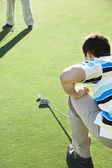 Asian man playing golf — Stock Photo