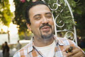 Hispanic man smoking cigar — Foto Stock