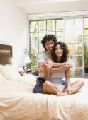 Couple hugging on bed — Stock Photo