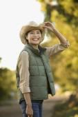 Asian woman wearing cowboy hat — Stock Photo
