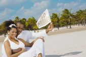 Multi-ethnic bride and groom at beach — Foto Stock