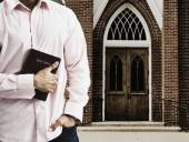 Mixed Race man holding the bible in front of church — Stock Photo