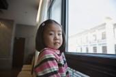 Asian girl next to window — Stock Photo