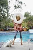 Hispanic woman holding life preserver next to swimming pool — Stock Photo