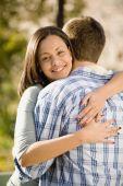 Hispanic woman hugging boyfriend — Stock Photo