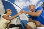 African couple setting up tent — Stock Photo