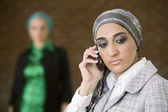 Middle Eastern businesswoman talking on cell phone — Stock Photo