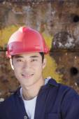 Asian male construction worker wearing hardhat — Stock Photo