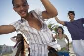 Hispanic teenaged boy with friends — Stock Photo