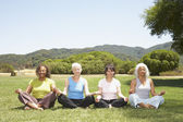 Multi-ethnic senior women meditating — Stock Photo