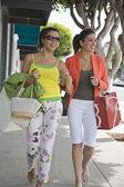 Women carrying shopping bags — Stock Photo