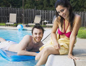 Middle Eastern couple in swimming pool — Stock Photo