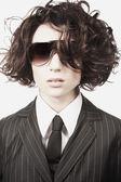 Businesswoman wearing sunglasses — Stock Photo