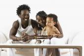 African mother celebrating birthday with family — Stock Photo