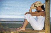 Mixed Race woman wearing straw hat — Stock Photo