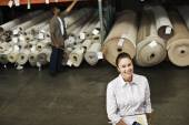Native American sales representative in carpet warehouse — Stock Photo