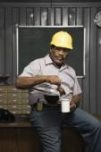 Male worker drinking coffee — Stock Photo