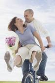 African American couple riding bicycle — Stock Photo