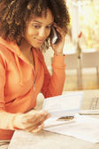 African American woman paying bills — Stock Photo