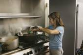 Hispanic woman preparing food — Stock Photo