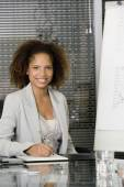 African businesswoman at conference table — Stock Photo