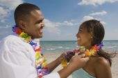 African couple wearing leis — Stock Photo