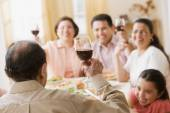 Hispanic family toasting at dinner table — Stock Photo