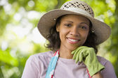 Woman wearing gardening glove — Stock Photo