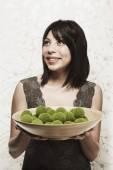 Hispanic woman holding home decor bowl — Stock Photo