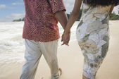 Pacific Islander couple walking on beach — Stock Photo