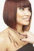 Pacific Islander woman having haircut — Stock Photo
