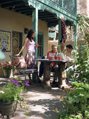 Multi-ethnic family on patio — Stock Photo