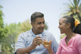 Multi-ethnic couple toasting with champagne — Stock Photo