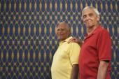 Senior man with hand on friend's shoulder — Stockfoto