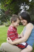 Asian mother and son laughing — Stock Photo