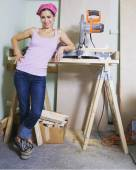 Middle Eastern woman next to table saw — Stock Photo