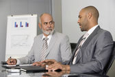 African businessmen having meeting — Stock Photo