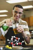 Mixed Race teenaged boy in science class — Stock Photo