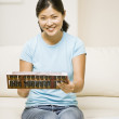 Asian woman holding abacus — Stock Photo #52070495
